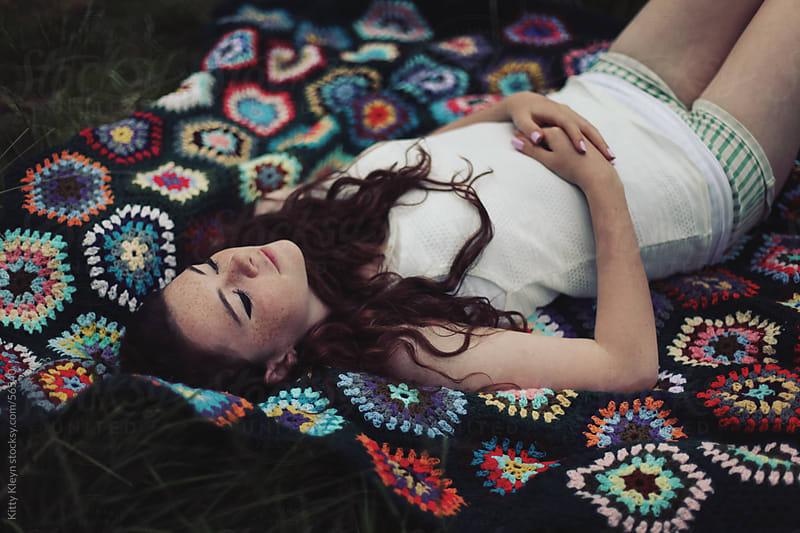 Girl sleeping by Kitty Gallannaugh for Stocksy United