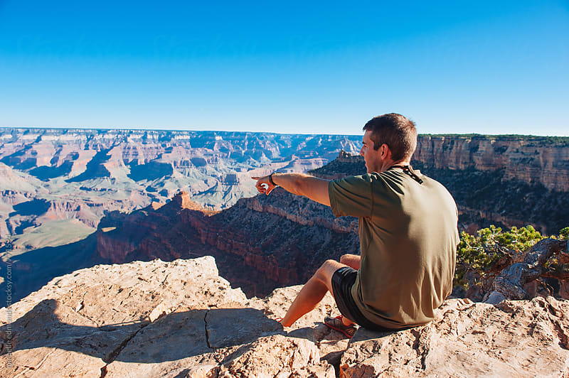 Man Pointing at a Grand Canyon Overlook by michelle edmonds for Stocksy United
