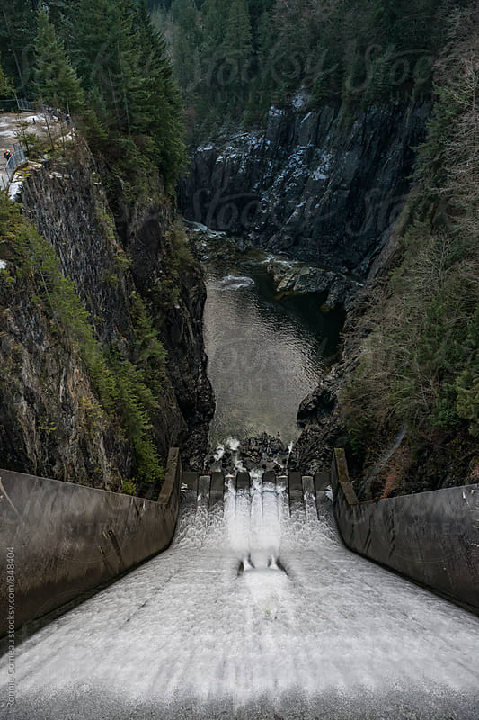 Dam In Rugged Area by Ronnie Comeau for Stocksy United