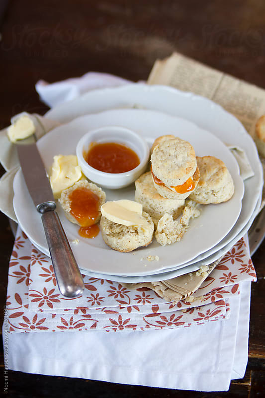 Scones with jam and butter by Noemi Hauser for Stocksy United