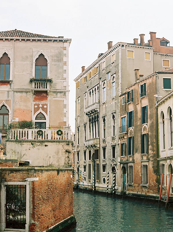 Residential buildings on canal in Venice by Kirstin Mckee for Stocksy United