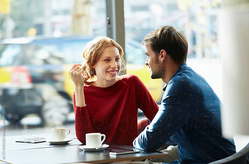 Happy Woman Talking With Boyfriend At Cafe Table by ALTO IMAGES for Stocksy United