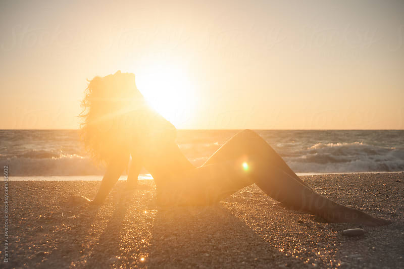 The girl on the beach enjoying the sun by Branislav Jovanović for Stocksy United