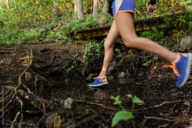 Trail Run Creek Crossing by Willie Dalton for Stocksy United