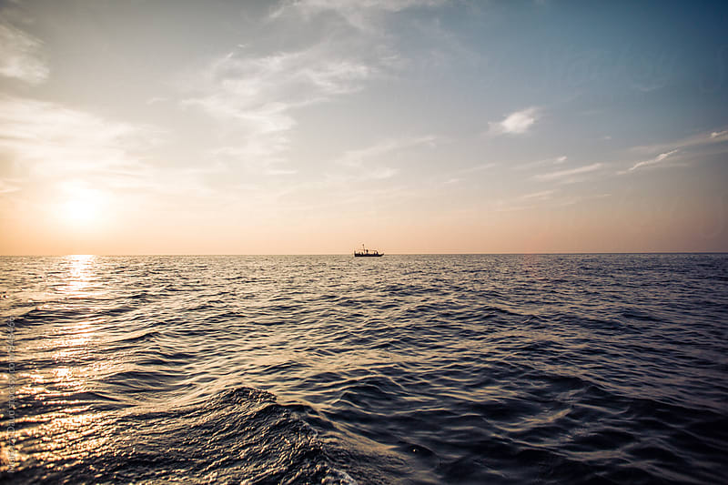 A view of the calm Ocean in pakistan by Murtaza Daud for Stocksy United