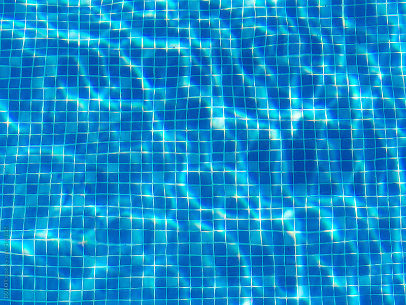 Blue Tiles on the bottom of a swimming pool on a sunny summer day by DV8OR for Stocksy United