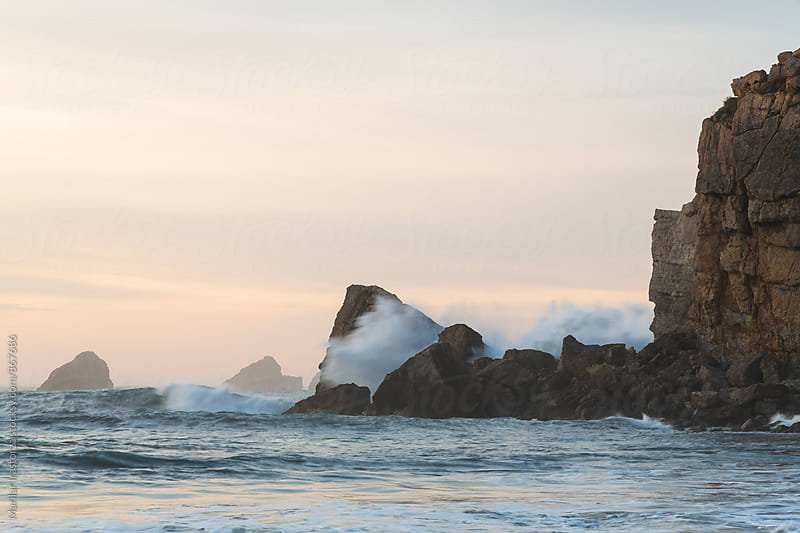 Waves knocking on the rocks at sunset by Marilar Irastorza for Stocksy United