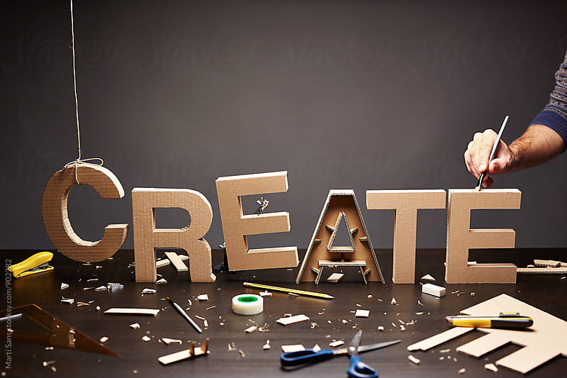 Handmade word 'Create' on wooden desktop by Martí Sans for Stocksy United