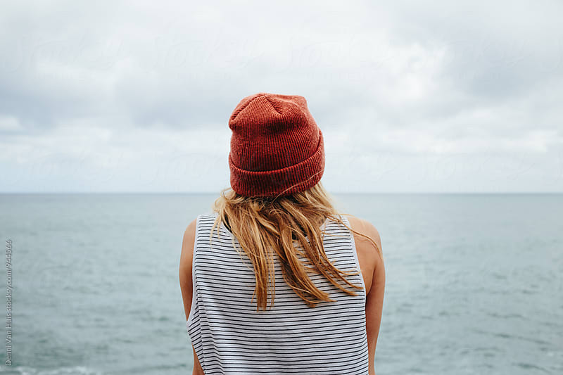 Woman overlooking the ocean by Denni Van Huis for Stocksy United