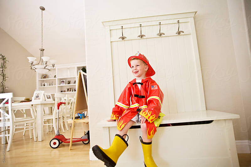 Little Boy Dressed Up in Fireman Costume by Dina Giangregorio for Stocksy United