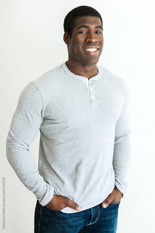 Smliling African American Man by Matthew Smith for Stocksy United