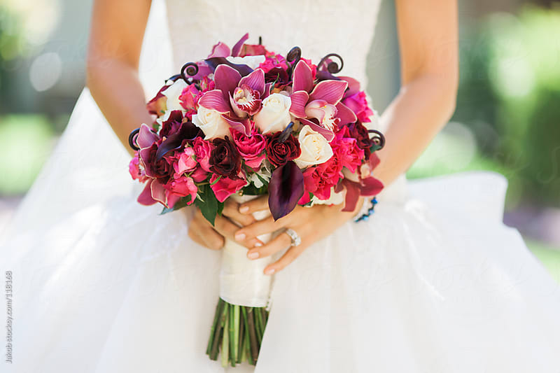 A bride holding a bouquet of flowers by Jakob for Stocksy United