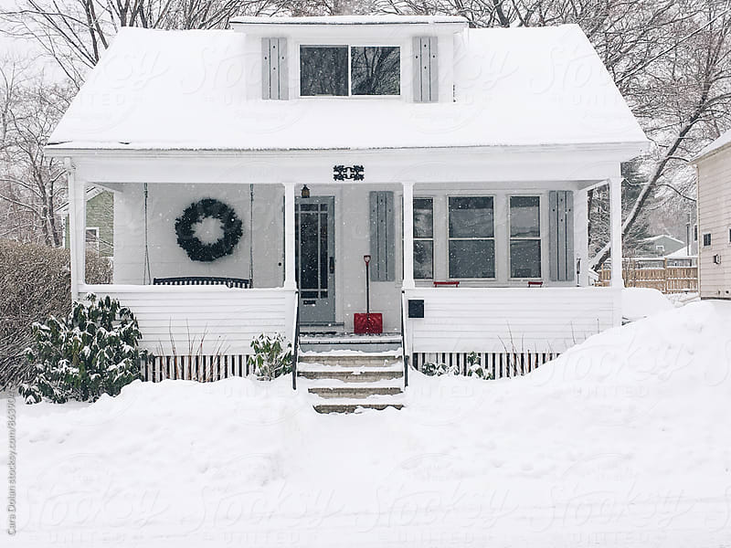 Little white house on a winter's day by Cara Slifka for Stocksy United