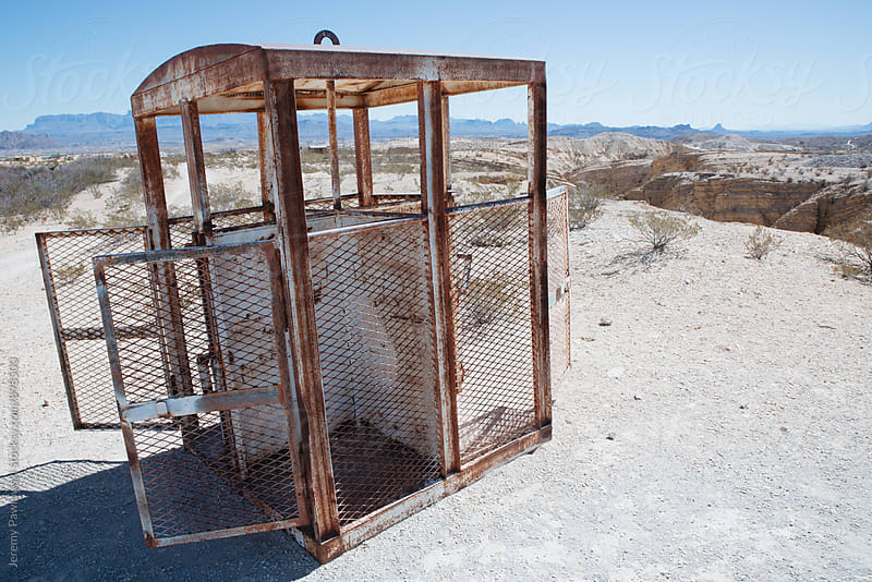 Abandoned rusty mine elevator car in the desert by Jeremy Pawlowski for Stocksy United