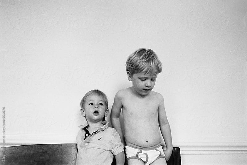 Cute brothers standing next to each other by Meghan Boyer for Stocksy United