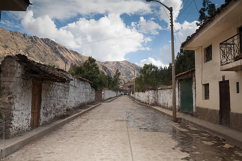 Andean town street lined by adobe walls by Ben Ryan for Stocksy United