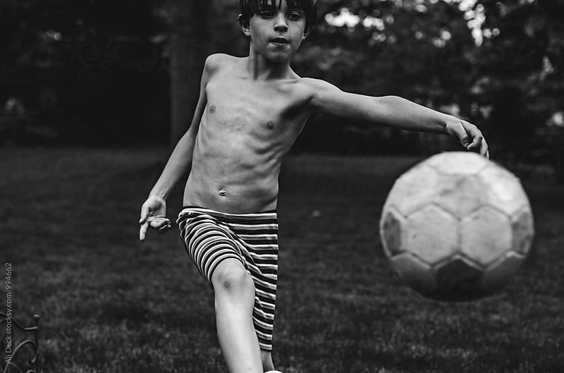 Boy and Soccer Ball by Ali Deck for Stocksy United