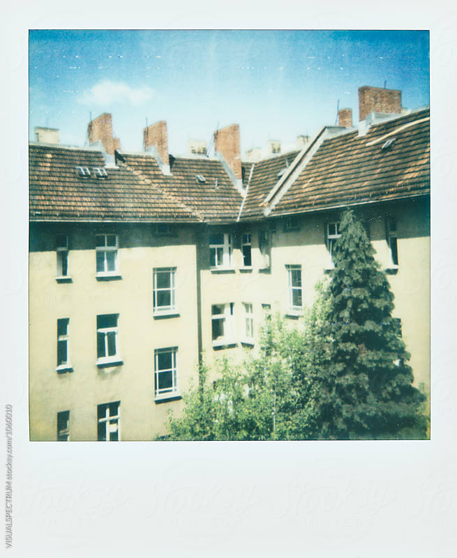 Instant Photograph of Old Berlin Apartment Building on Sunny Day by Julien L. Balmer for Stocksy United