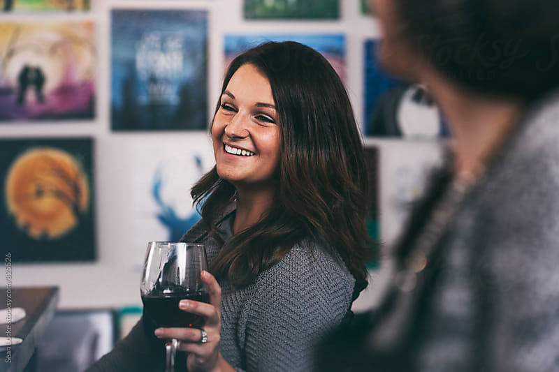Painting: Woman Laughing During Art Party by Sean Locke for Stocksy United