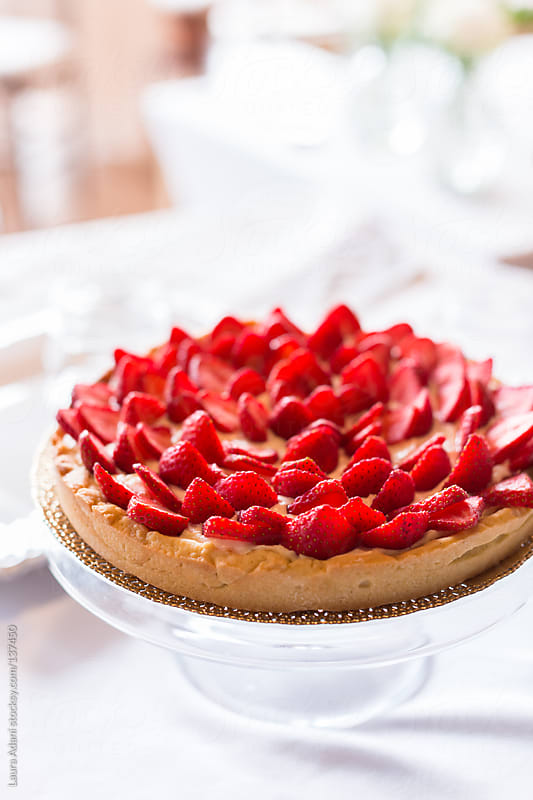 strawberries tart by Laura Adani for Stocksy United