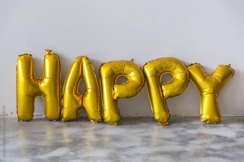 Gold balloons that spell the word 'HAPPY'  by Jacqui Miller for Stocksy United
