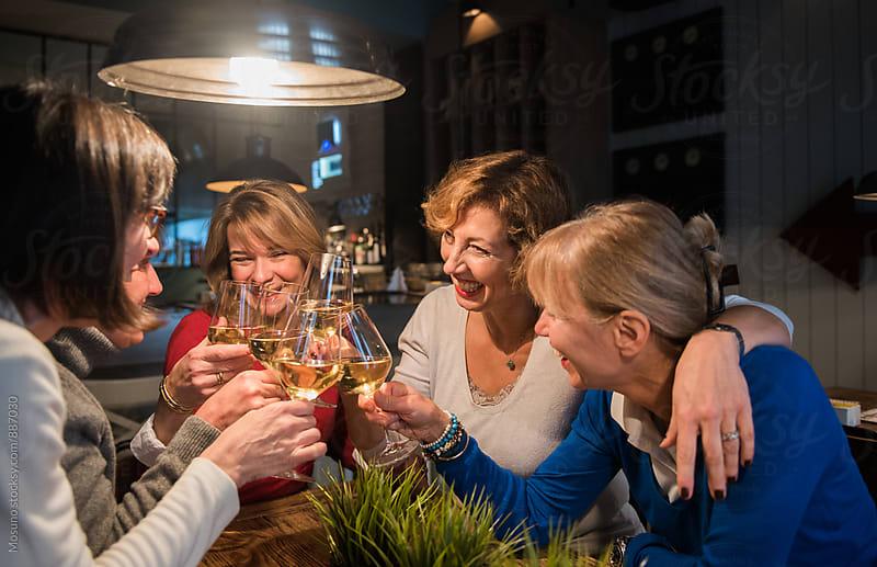 Senior Women Having Wine in a Restaurant by Mosuno for Stocksy United