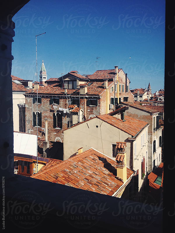 Window view on rooftops of Venice by Liubov Burakova for Stocksy United