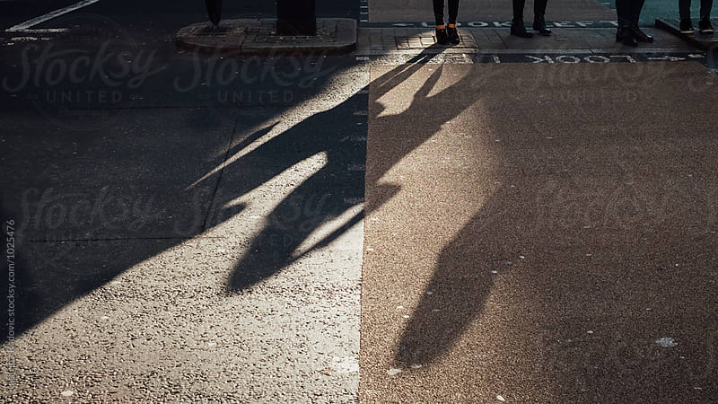 People Crossing the Street by Katarina Radovic for Stocksy United