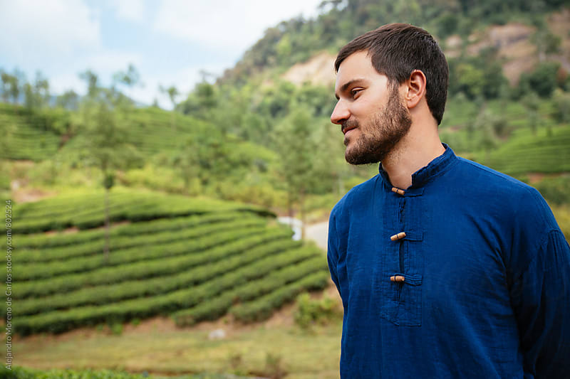 Side view of a man looking at green tea plantations scenery. Munnar, India. by Alejandro Moreno de Carlos for Stocksy United