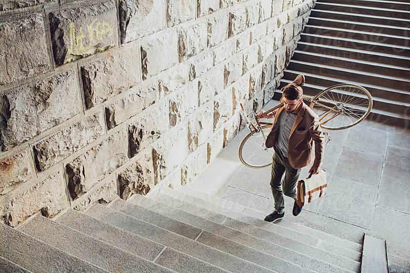 Businessman With a Bike by Lumina for Stocksy United