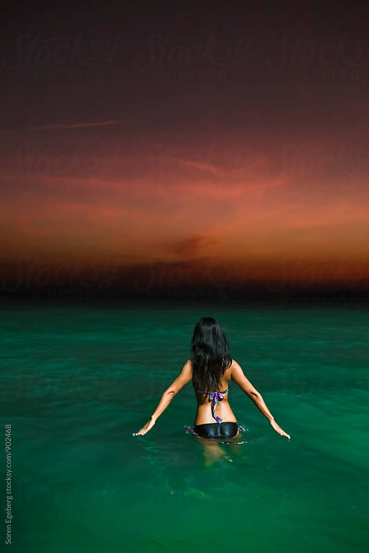 Girl going night swimming in the ocean by Soren Egeberg for Stocksy United