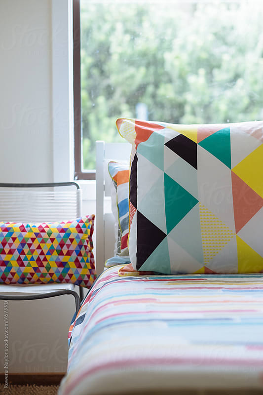 Colorful design in bedroom by Rowena Naylor for Stocksy United