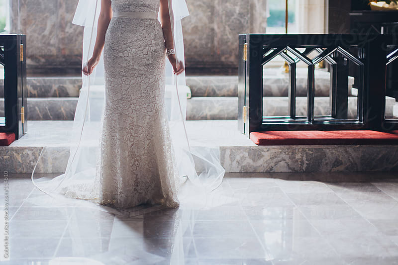 Bride on Alter Crop by Gabrielle Lutze for Stocksy United