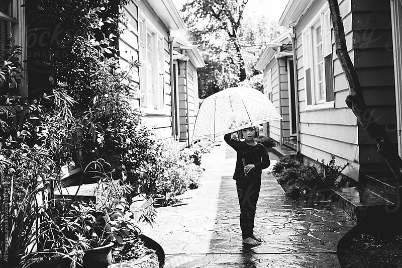 Barefoot in the rain by Ali Lanenga for Stocksy United