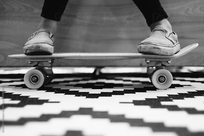 Kids feet resting on skateboard by Kristine Weilert for Stocksy United