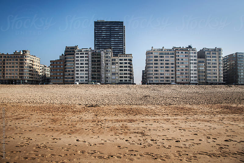 sand beach and buildings by Sonja Lekovic for Stocksy United