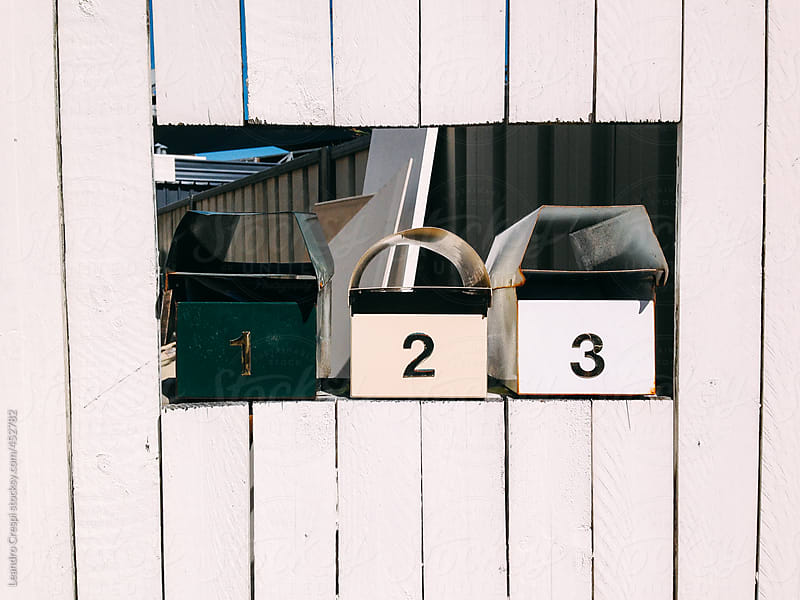 Letter boxes on a wooden wall by Leandro Crespi for Stocksy United