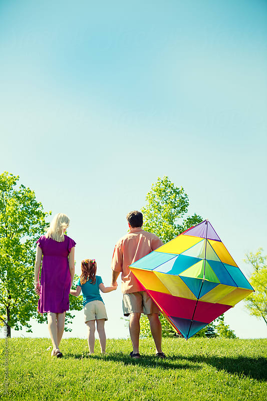 Park: Family Ready to Fly a Kite by Sean Locke for Stocksy United