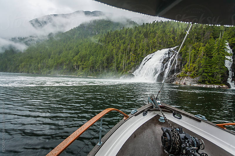 Boat ride adventure through the British Columbia's Great Bear Rainforest. by Robert Zaleski for Stocksy United