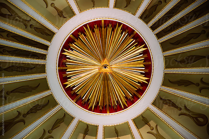 God´s eye symbol in the roof of a building by Alejandro Moreno de Carlos for Stocksy United
