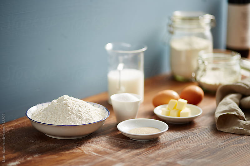 Ingredients for preparing bread dough by Martí Sans for Stocksy United