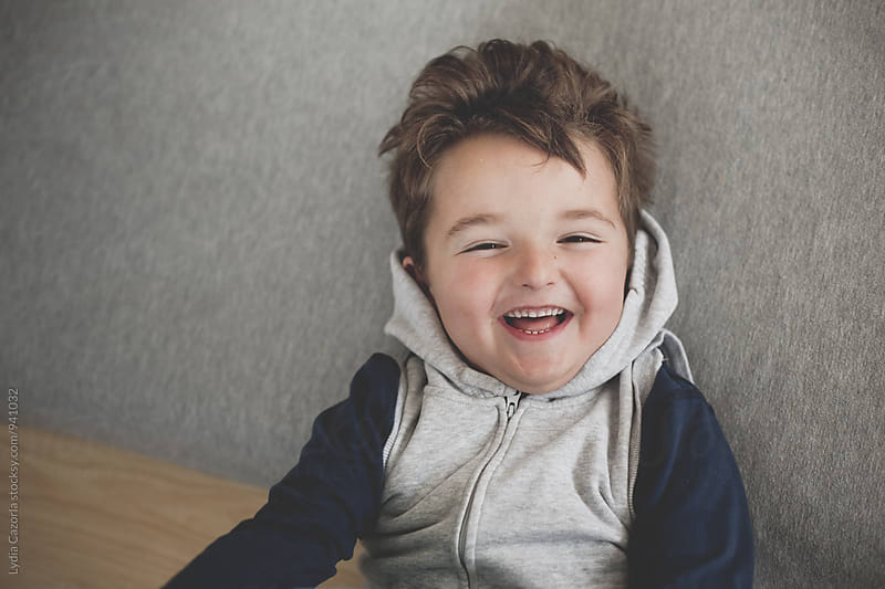 Child laughing  by Lydia Cazorla for Stocksy United