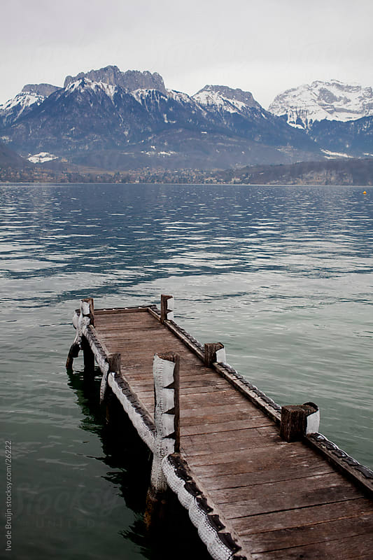 A small wooden pier or wharf in a mountain lake in the French Alpes by Ivo de Bruijn for Stocksy United