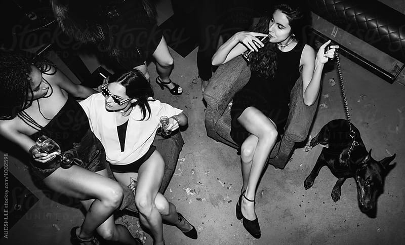 Champagne,dog and stylish females on party. by Marko Milanovic for Stocksy United