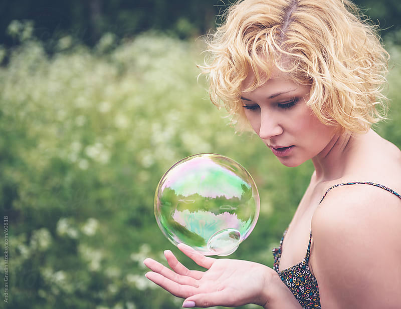 soap bubble girl by Andreas Gradin for Stocksy United