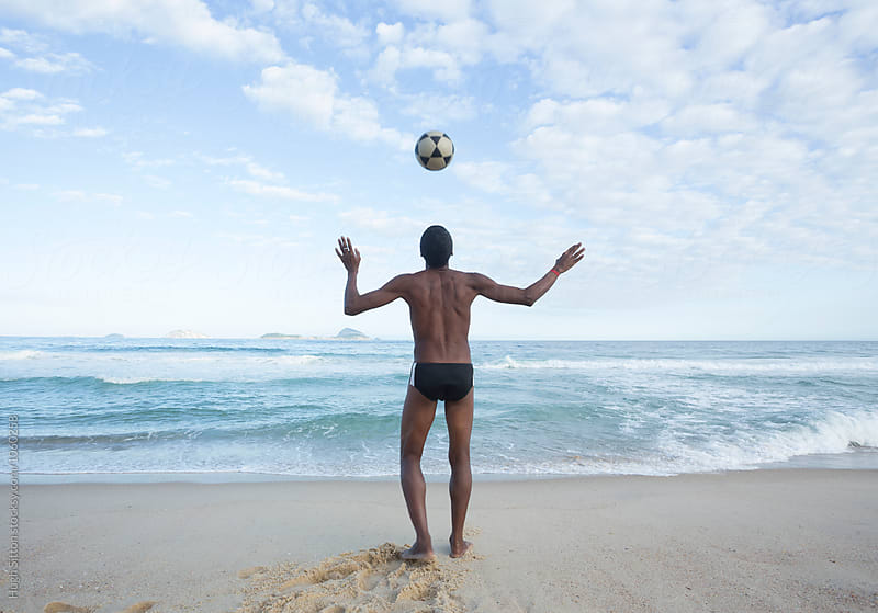 Brazilian man on Ipanema beach. Rio. Brazil. by Hugh Sitton for Stocksy United