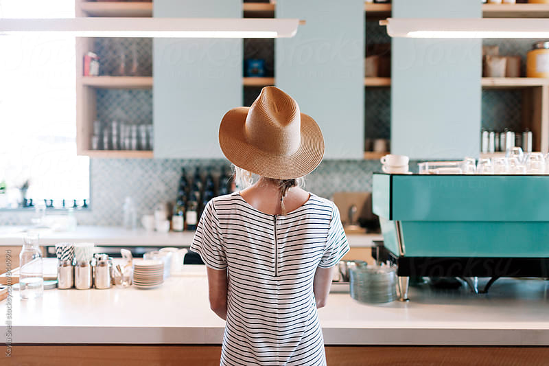 Woman in a cafe by Kayla Snell for Stocksy United