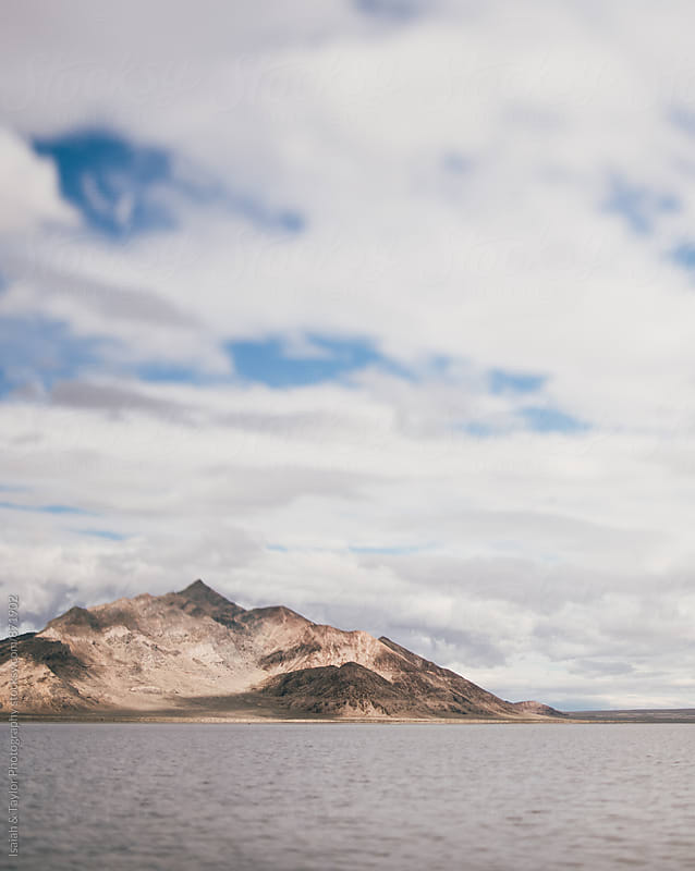 Desert mountain and lake by Isaiah & Taylor Photography for Stocksy United
