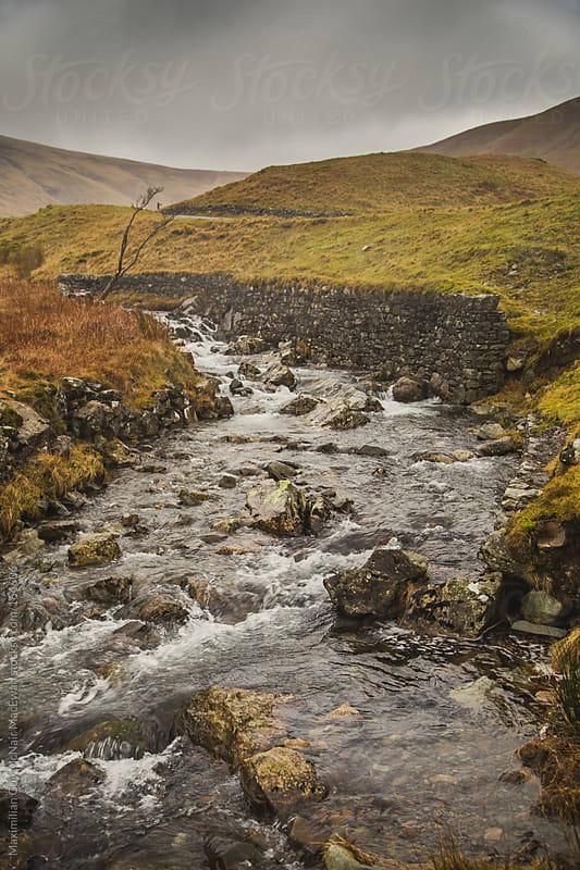 A rapid river in Autumn by Maximilian Guy McNair MacEwan for Stocksy United