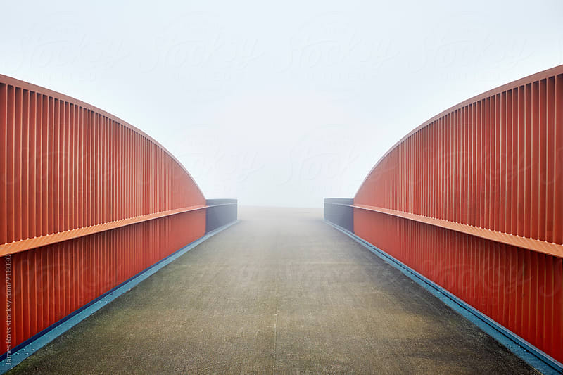 An empty bridge shrouded in fog by James Ross for Stocksy United